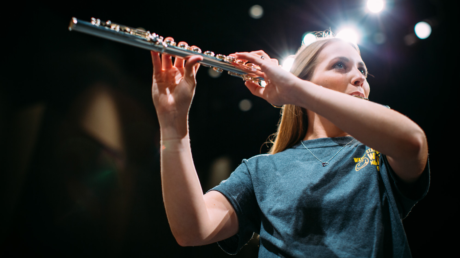 A WSC student plays the flute on stage in Ramsey Theatre