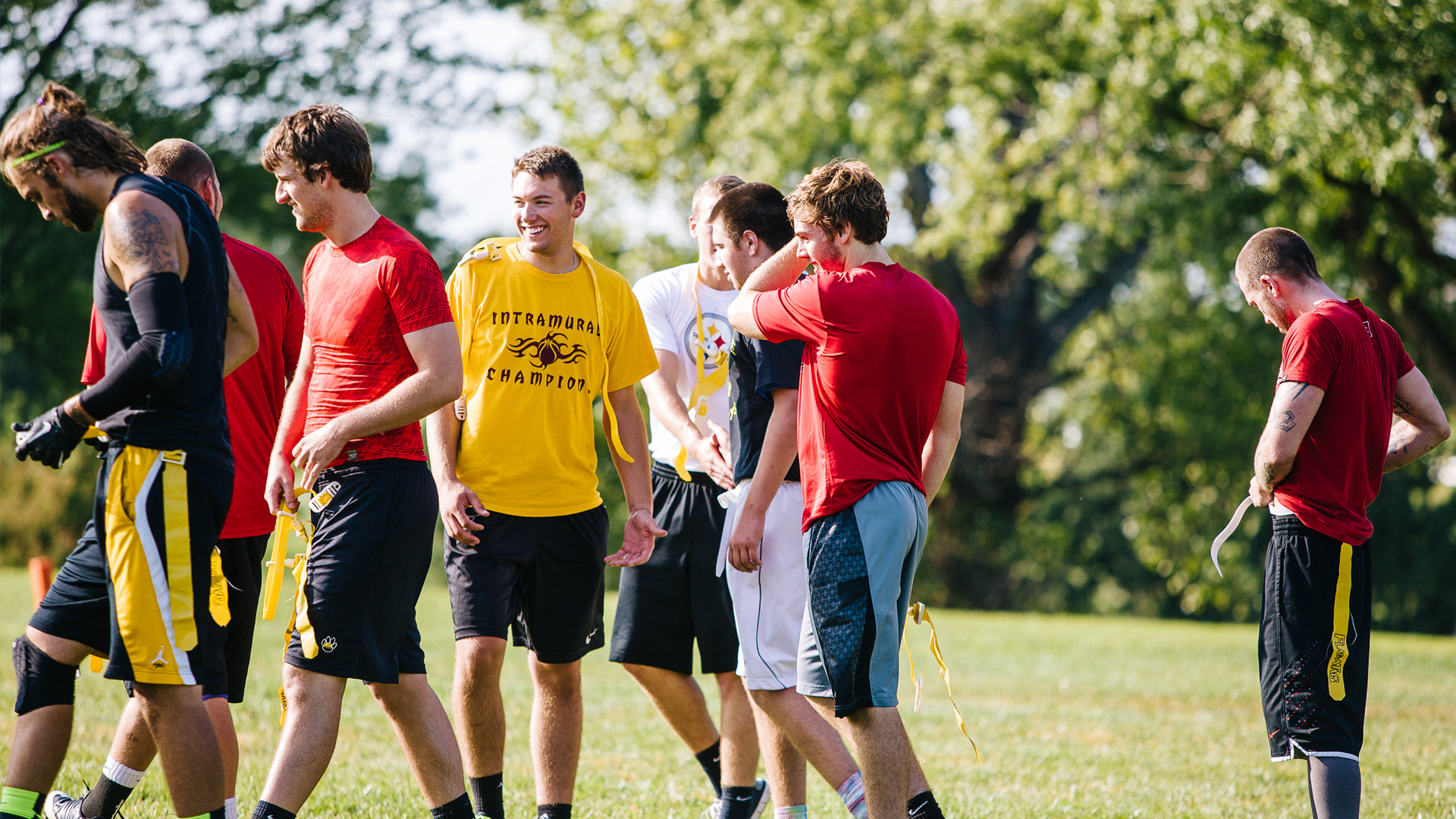 Students play flag football on campus