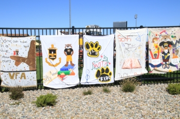 "Homecoming ""Wild with Pride"" student banners are displayed at Memorial Stadium."