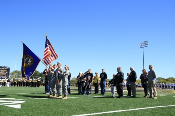 Wayne State military alumni joined members of the 189th Transportation Company as they presented the colors at the football game.