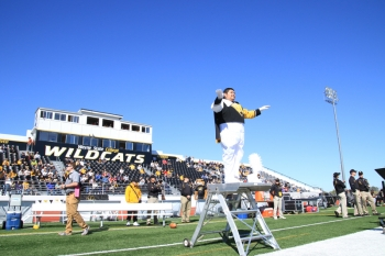 Drum major Adrian Campos directs the Wildcat Marching Band.