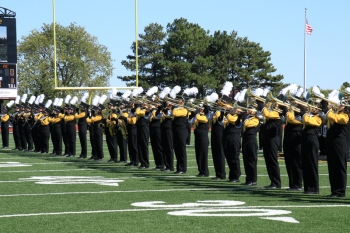 The Wildcat Marching Band performs the national anthem at the football game.