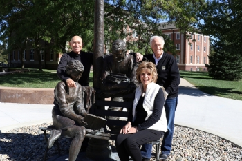 Herb '55-59 and Sherry Mignery pose with former WSC President Dr. Don Mash at one of Herb's campus sculptures.
