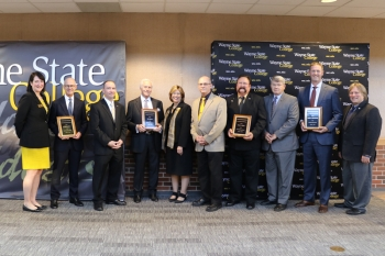 The Wayne State College deans presented the four outstanding alumni with their awards.