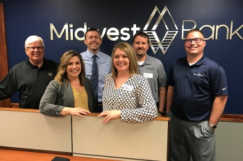 Midwest Bank hosted and sponsored a Wayne State GOLD Club Business After Hours event on Tuesday, May 9 in Norfolk. Pictured are Midwest Bank alumni hosts (left to right): Pat Hughes '73, Marcy Kratochvil '05, Jason Love '06, Amy Schroete