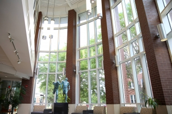 "Inside east entrance, looking north. The featured sculpture ""The Finish"" was created by A. Thomas Schomberg '64."