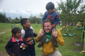 A Wayne State student plays with children of the Achuar tribe