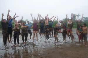 Students having fun in the mud on a rainy day in Ecuador
