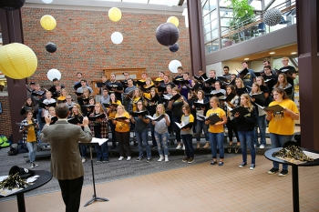 The Wayne State Concert Choir performs at the Alumni Employee Appreciation Social in the Kanter Student Center.