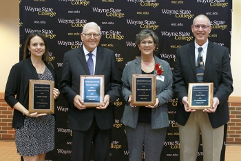 Danelle Smith '98 (Business & Technology), Merle Larson '59 (Arts & Humanities), Diane Sabatka-Rine '84 (Natural & Social Sciences), and Bob Uhing, MSE '86, '88, Ed. S. '91 were honored with Outstanding Alumni Awards.