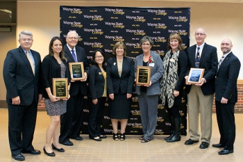 The Outstanding Alumni Award recipients with President Rames and deans
